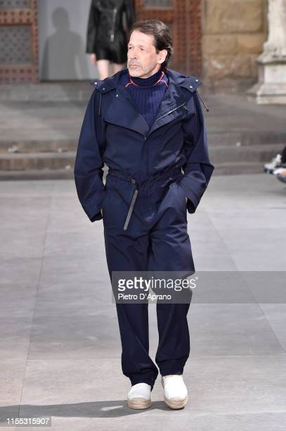 Peter Saville walks the runway at the Salvatore Ferragamo fashion show in Piazza della Signoria during Pitti Immagine Uomo 96 on June 11 2019 in...