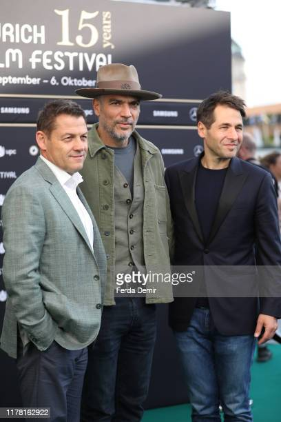 """Peter Schaumlechner, Andrea Di Stefano and ZFF Co-Festival director Karl Spoerri attend the """"The Informer"""" photo call during the 15th Zurich Film..."""