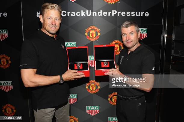 Peter Schmeichel and Denis Irwin attend the Launch of New TAG Heuer Manchester United Watches at the TAG Heuer Boutique on July 30 2018 in Aventura FL