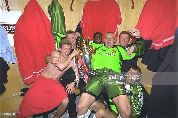 Peter Schmeichel celebrates with Jesper Blomqvist, Raimond van der Gouw, Dwight Yorke, Steve McClaren and Jim Ryan after the FA Carling Premiership...