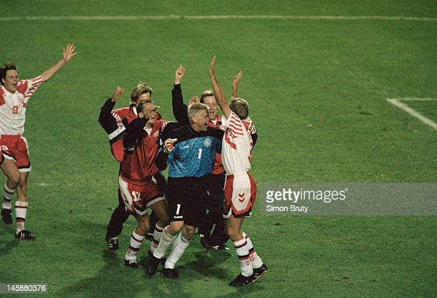 Peter Schmeichel of Denmark celebrates victory with his team-mates in the penalty shoot-out to send Denmark into the final during the UEFA European...