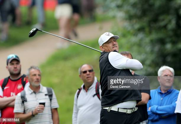 Peter Schmeichel of Denmark the former Danish and Manchester United soccer star plays a shot during the proam for the 2018 BMW PGA Championship on...