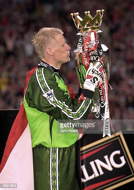 Peter Schmeichel of Manchester United kisses the FA Premiership trophy after the FA Carling Premiership match between Manchester United v Tottenham...