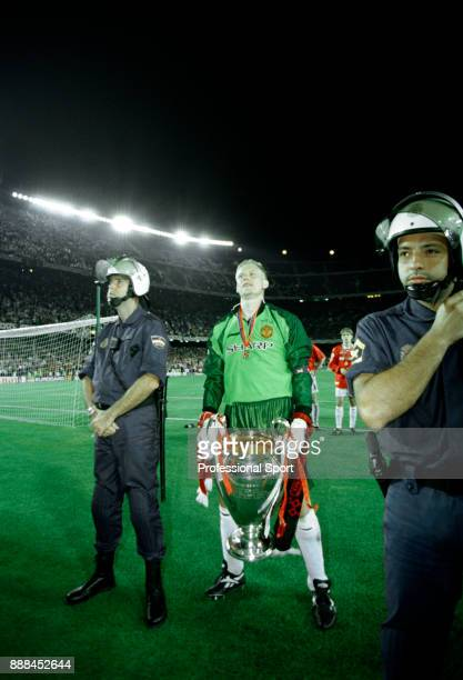Peter Schmeichel of Manchester United with the European Cup after victory in the UEFA Champions League Final between Manchester United and Bayern...