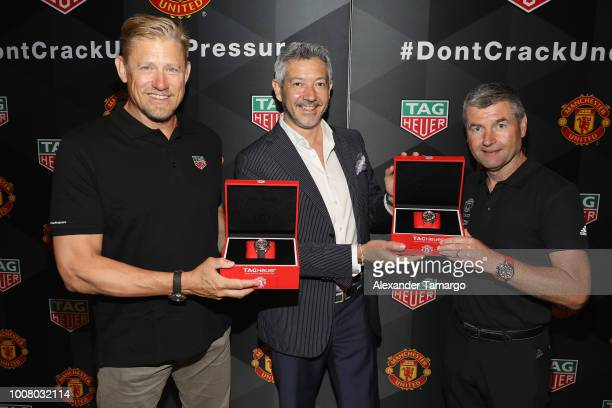Peter Schmeichel Vice President of Marketing for TAG Heuer Andrea Soriani and Denis Irwin attend the Launch of New TAG Heuer Manchester United...