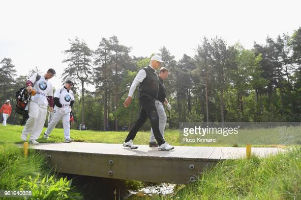 Peter Schmeichel walks with Matt Le Tissier during the Pro Am for the BMW PGA Championship at Wentworth on May 23 2018 in Virginia Water England