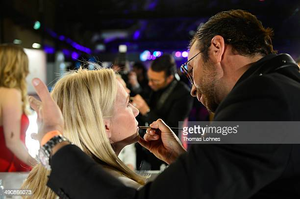 Peter Schmidinger and a model attend Babor at the Duftstars Awards 2014 at arena Berlin on May 15 2014 in Berlin Germany