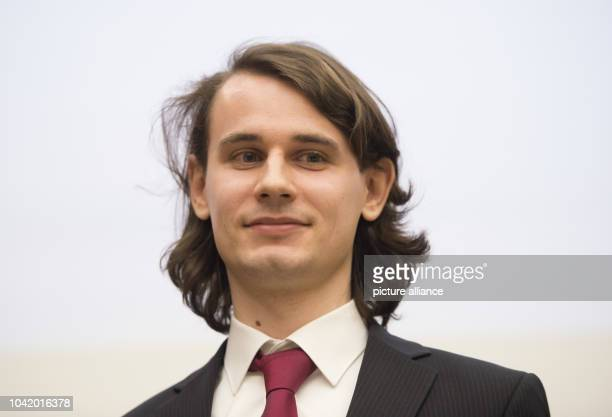 Peter Scholze, Mathematical Institute, University of Bonn, poses after winning an award during the Gottfried Wilhelm Leibniz Prize award ceremony in...