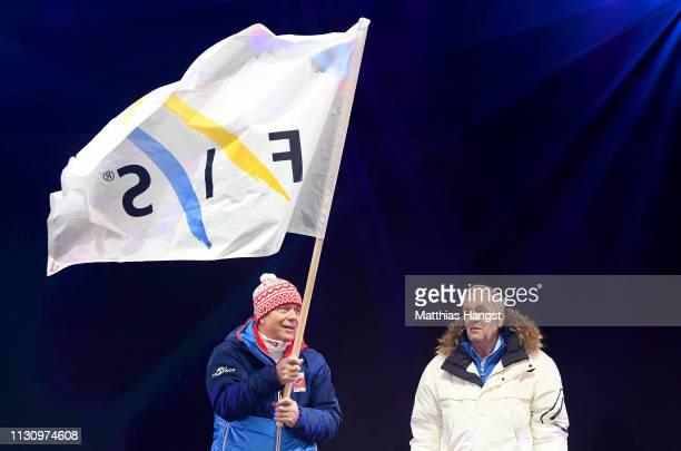 Peter Schroecksnadel president of ÖSV waves the FIS flag next to Gian Franco Kasper president of FIS during the opening ceremony for the FIS Nordic...