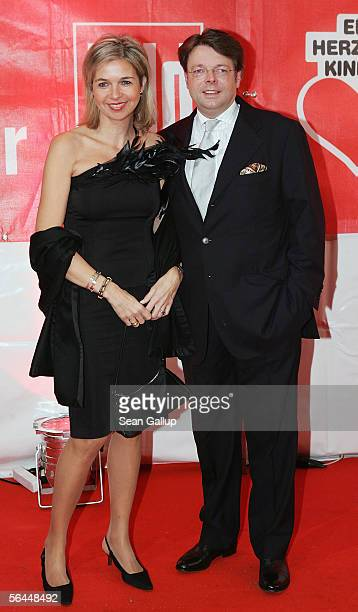 Peter Schwenkow and his wife Inga GrieseSchwenkow arrive at the Ein Herz Fuer Kinder television charity gala at the Axel Springer Halle December 17...