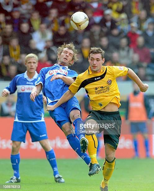 Peter Schyrba of Rostock and Maik Kegel of Dresden battle for the ball during the Third League match between Dynamo Dresden and Hansa Rostock at...