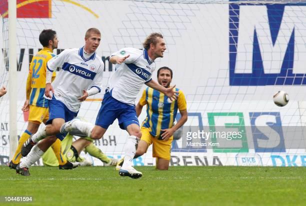 Peter Schyrba of Rostock jubilates after scoring the third goal during the Third League match between FC Hansa Rostock and Eintracht Braunschweig at...