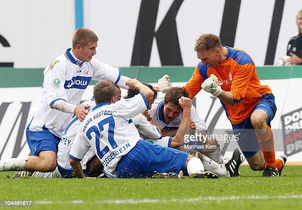 Peter Schyrba of Rostock jubilates with team mates after scoring the third goal during the Third League match between FC Hansa Rostock and Eintracht...