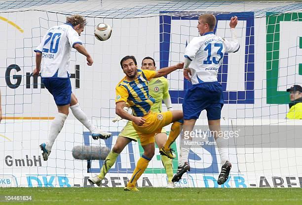 Peter Schyrba of Rostock scores the third goal during the Third League match between FC Hansa Rostock and Eintracht Braunschweig at DKB Arena on...
