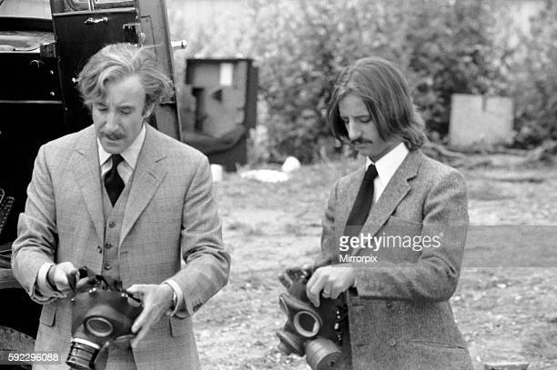 Peter sellers and Ringo Starr prepare to put on gas masks in a scene from the film in which they give money away free but in order to get it you have...