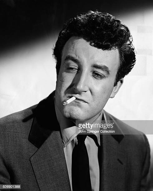 Peter Sellers as he appears in the role of 'Mr Robinson' alias Harry a member of the 'Guinness Gang' in the Michael BalconEaling Studios...