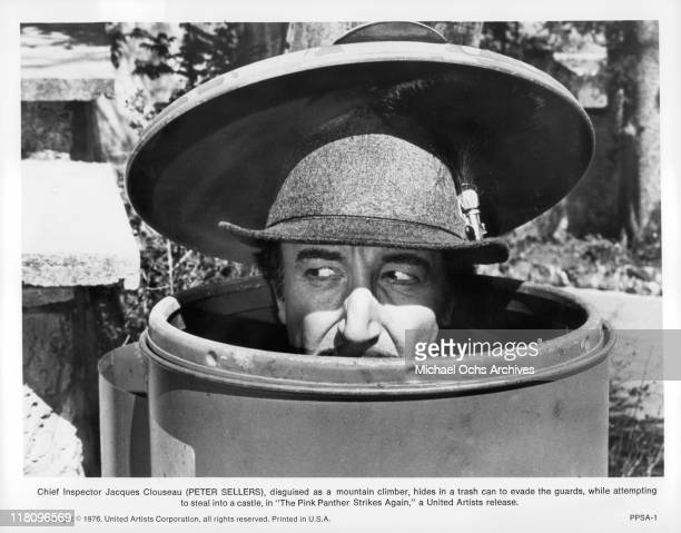 Peter Sellers as Inspector Clouseau is disguised as a mountain climber while hiding in a trash can in a scene from the film 'The Pink Panther Strikes...