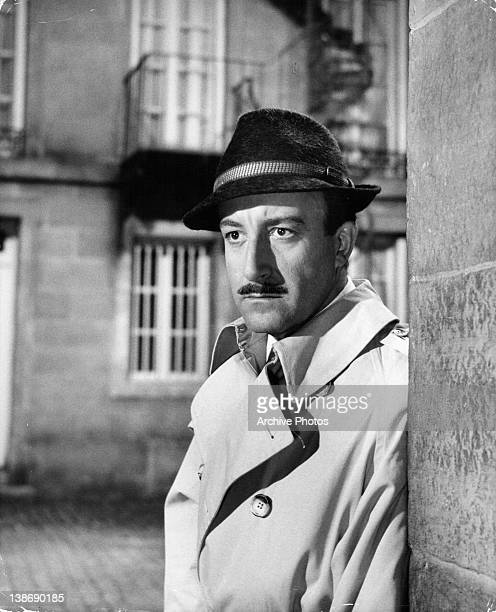 Peter Sellers looking around corner in a scene from the film 'A Shot In The Dark' 1964