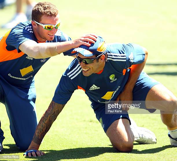 Peter Siddle comforts Mitchell Johnson after he was hit in the groin during an Australian training session at the WACA on December 13 2010 in Perth...