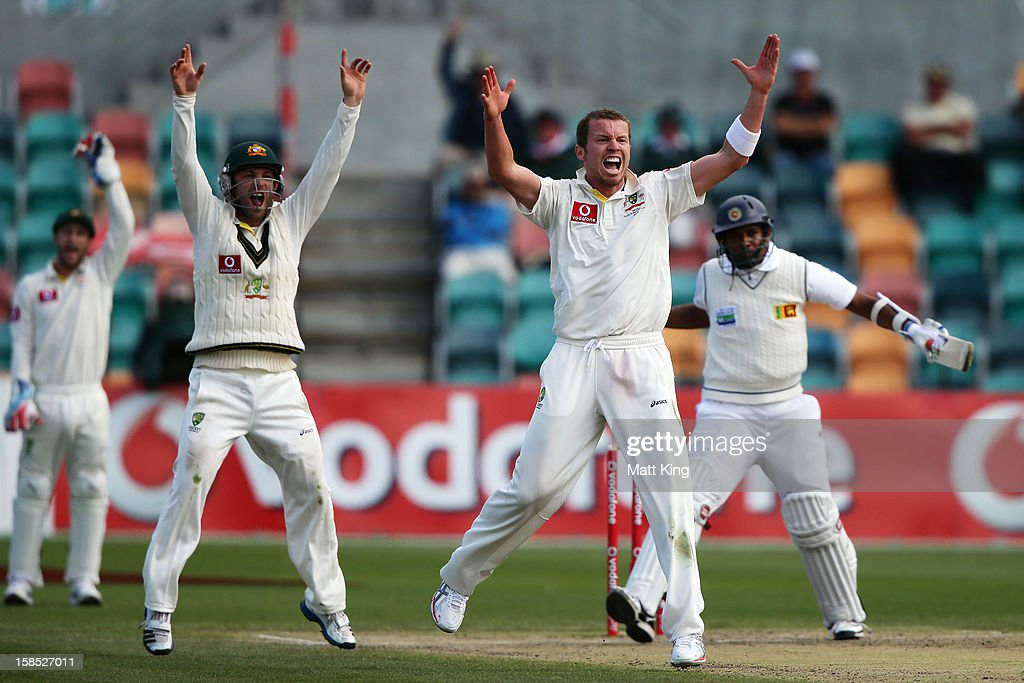 Peter Siddle of Australia appeals successfully for the wicket of Thilan Samaraweera of Sri Lanka during day five of the First Test match between Australia and Sri Lanka at Blundstone Arena on December 18, 2012 in Hobart, Australia.