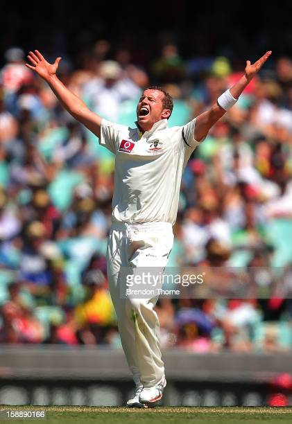 Peter Siddle of Australia celebrates after claiming the wicket of Thilan Samaraweera of Sri Lanka during day one of the Third Test match between...