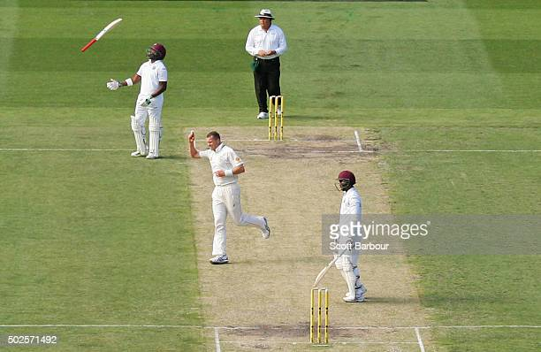 Peter Siddle of Australia celebrates after dismissing Denesh Ramdin of the West Indies as non striker Darren Bravo of the West Indies throws his bat...