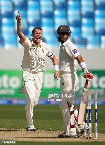 Peter Siddle of Australia celebrates after taking the wicket of Ahmed Shehzad of Pakistan during Day One of the First Test between Pakistan and...