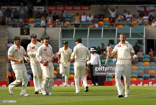 Peter Siddle of Australia celebrates after taking the wicket of Matt Prior of England during day one of the First Ashes Test match between Australia...