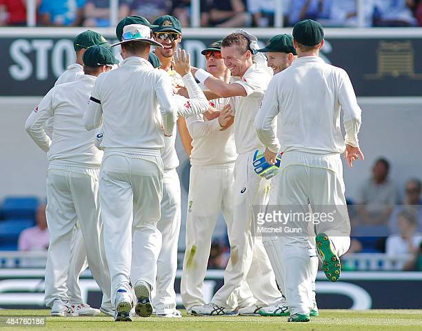 Peter Siddle of Australia celebrates taking the wicket of Adam Lyth of England during day two of the 5th Investec Ashes Test match between England...