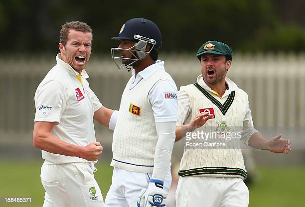 Peter Siddle of Australia celebrates the wicket of Kumar Sangakkara of Sri Lanka during day five of the First Test match between Australia and Sri...