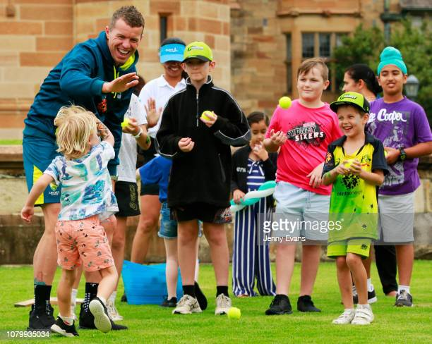 Peter Siddle of Australia high fives a boy after bowling during the Cricket Australia Fan Day at the University of Sydney on January 10 2019 in...