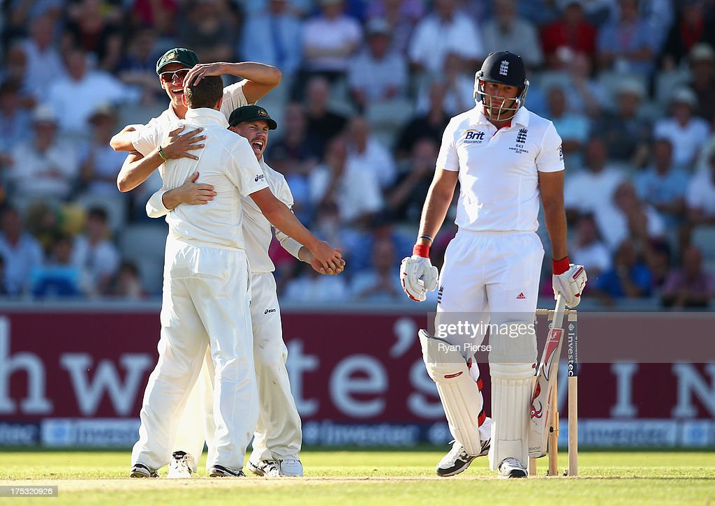 Peter Siddle of Australia is congratulated by David Warner and Mitchell Starc of Australia after he claimed the wicket of Tim Bresnan of England during day two of the 3rd Investec Ashes Test match between England and Australia at Emirates Old Trafford Cricket Ground on August 2, 2013 in Manchester, England.