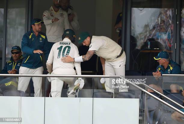 Peter Siddle of Australia is congratulated by James Pattinson of Australia after he was dismissed for 44 runs during Day One of the 1st Specsavers...