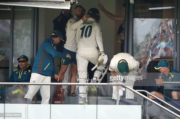 Peter Siddle of Australia is congratulated by Matthew Wade of Australia after he was dismissed for 44 runs during Day One of the 1st Specsavers Ashes...