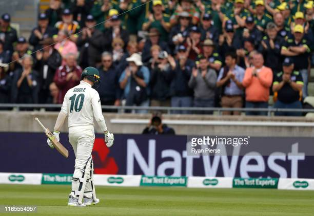 Peter Siddle of Australia looks dejected after being dismissed by Moeen Ali of England during Day One of the 1st Specsavers Ashes Test between...