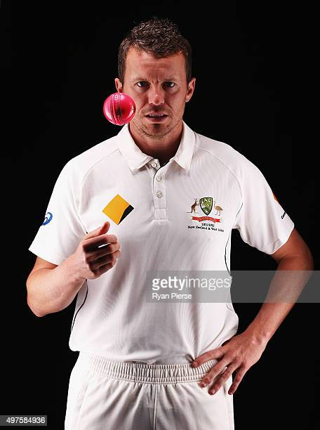 Peter Siddle of Australia poses with a Pink Day Night Test Ball during an Australian Test Cricket Portrait Session on October 19 2015 in Sydney...