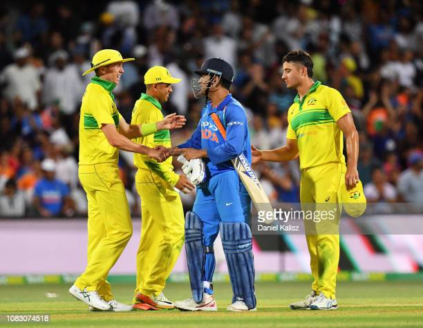Peter Siddle of Australia shakes hands with MS Dhoni of India after defeating Australia during game two of the One Day International series between...