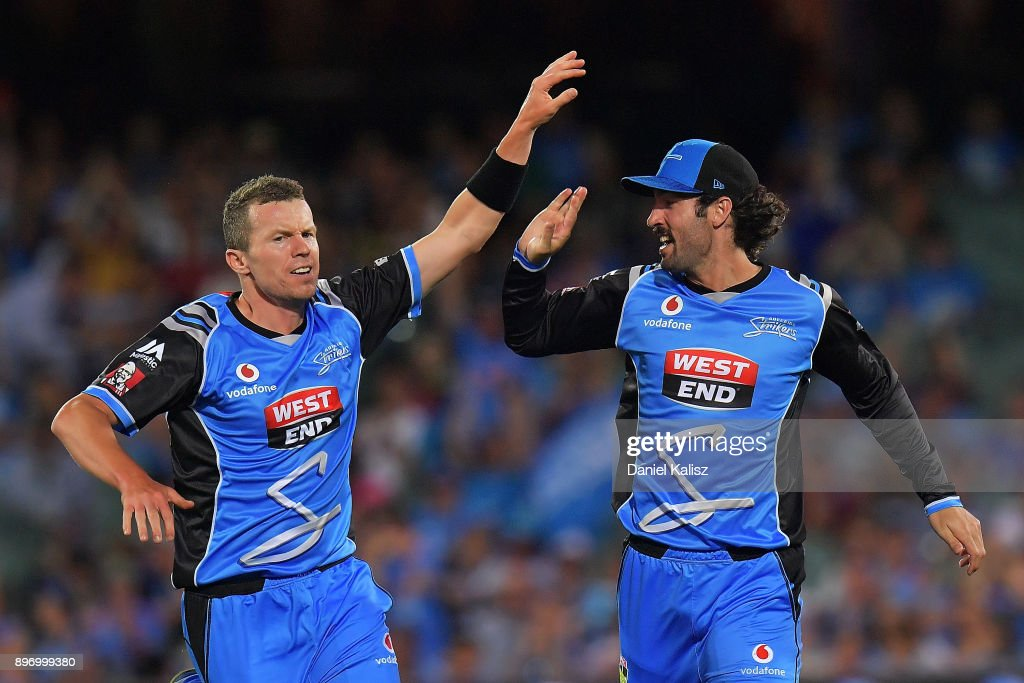 Peter Siddle of the Adelaide Strikers and Jono Dean of the Adelaide Strikers celebrate during the Big Bash League match between the Adelaide Strikers and the Sydney Thunder at Adelaide Oval on December 22, 2017 in Adelaide, Australia.