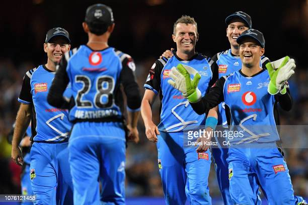 Peter Siddle of the Adelaide Strikers celebrates with his team mates after taking a wicket during the Big Bash League match between the Adelaide...