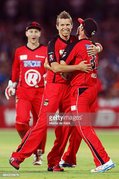 Peter Siddle of the Renegades celebrates with teammates after getting a wicket of during the Big Bash League match between the Adelaide Strikers and...