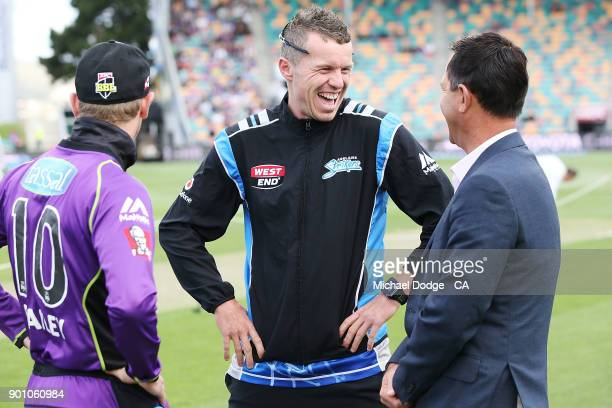 Peter Siddle of the Strikers catches up with Ricky Ponting and George Bailey of the Hurricanes during the Big Bash League match between the Hobart...