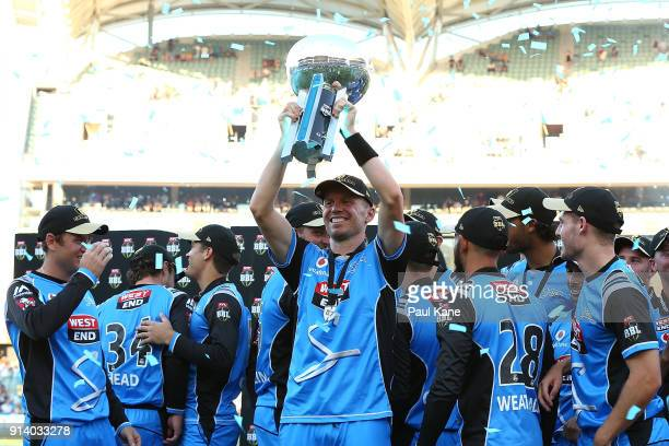 Peter Siddle of the Strikers holds the trophy aloft after winning the Big Bash League Final match between the Adelaide Strikers and the Hobart...