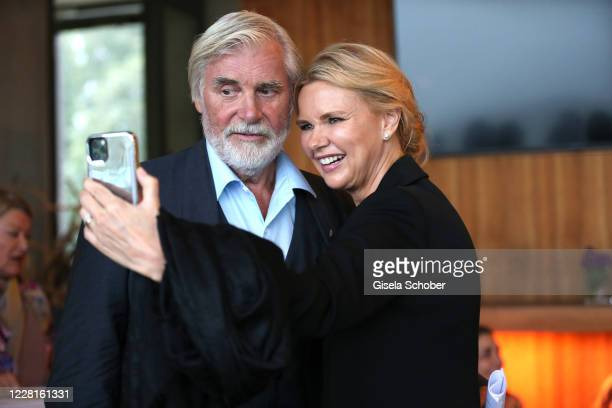 """Peter Simonischek and Veronica Ferres take a selfie during the reading of """"Jedermann"""" according to the 100th anniversary of the Salzburg Opera..."""