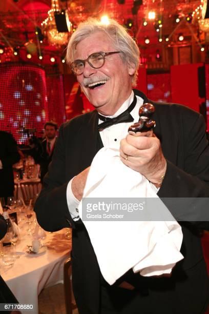 Peter Simonischek polishes his award during the ROMY award at Hofburg Vienna on April 22 2017 in Vienna Austria