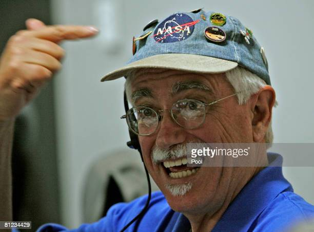 Peter Smith Principal Investigator Univ of Arizona points to his NASA cap with Mars landing pins in the NASA/JPL mission control room before the...
