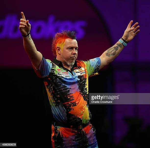 Peter 'Snakebite' Wright of England celebrates after winning his first round match against Joe Cullen of England during the Ladbrokescom World Darts...