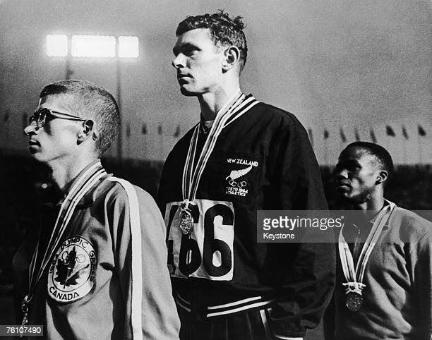 Peter Snell of New Zealand on the podium at the Olympics in Tokyo after winning the 800 Metres event 18th October 1964 With him are silver medalist...