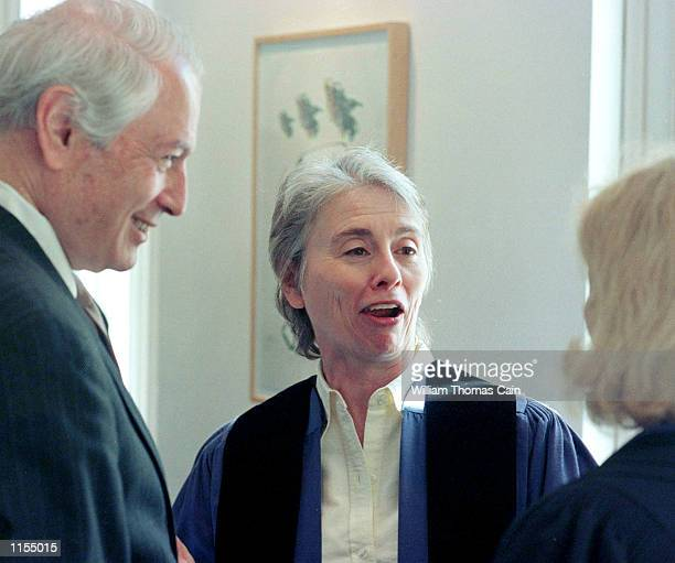 Peter Solmssen, left, President of The University of the Arts, Camille Paglia, center, and Provost Virginia Red, share a laugh before the start of...