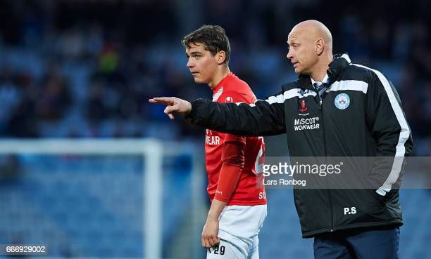 Peter Sorensen head coach of Silkeborg IF speaks to Robert Skov of Silkeborg IF during halftime in the Danish Alka Superliga match between AGF Aarhus...