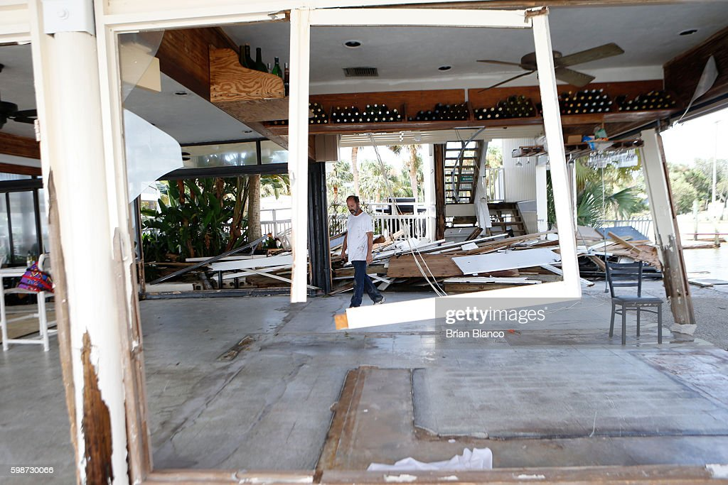 Peter Stafani, owner of the Cedar Cove resort, surveys damage to what had been the bar area of his property left behind by the winds and storm surge associated with Hurricane Hermine which made landfall overnight in the area on September 2, 2016 in Cedar Key, Florida. Hermine made landfall as a Category 1 hurricane but has weakened back to a tropical storm.